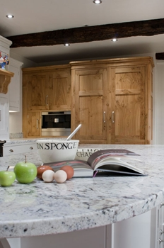 Built in Miele larder refrigeration. Work surfaces in Delicatus cream granite