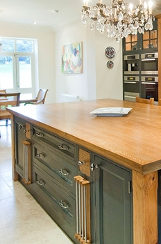 Oak & hand painted island shown here with pull out lap trays