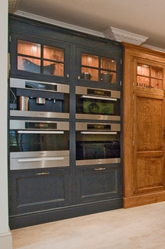 Miele appliances housed in rich blue hand painted cabinets